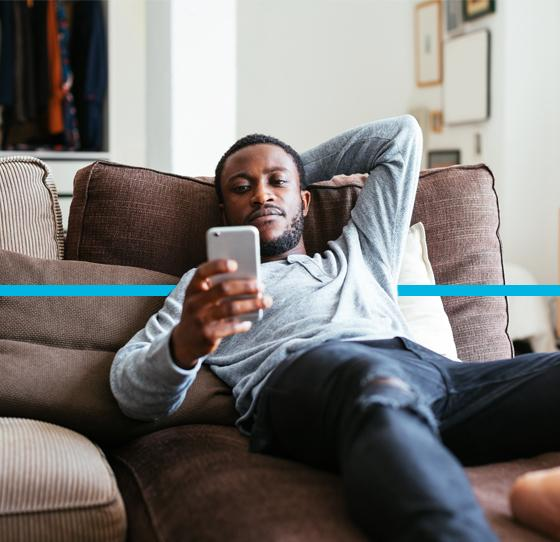 Man relaxing on couch.